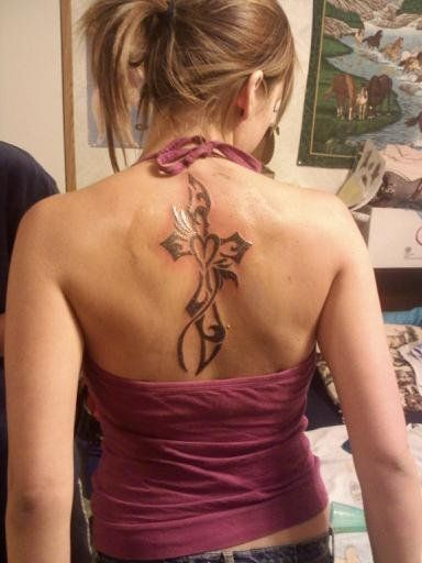 A Small Heart And A Big Cross Tattoo On Back Tattoos Ideas And Designs