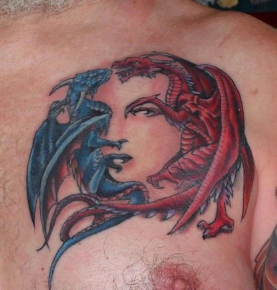 The Two Dragons Fighting In This Tattoo Design Are Ideas And Designs