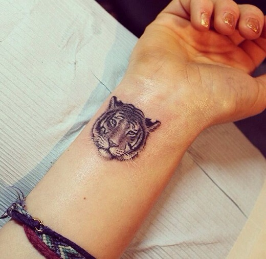 Small And Nice Tiger Face Tattoo On Wrist For Stylish Girl Ideas And Designs