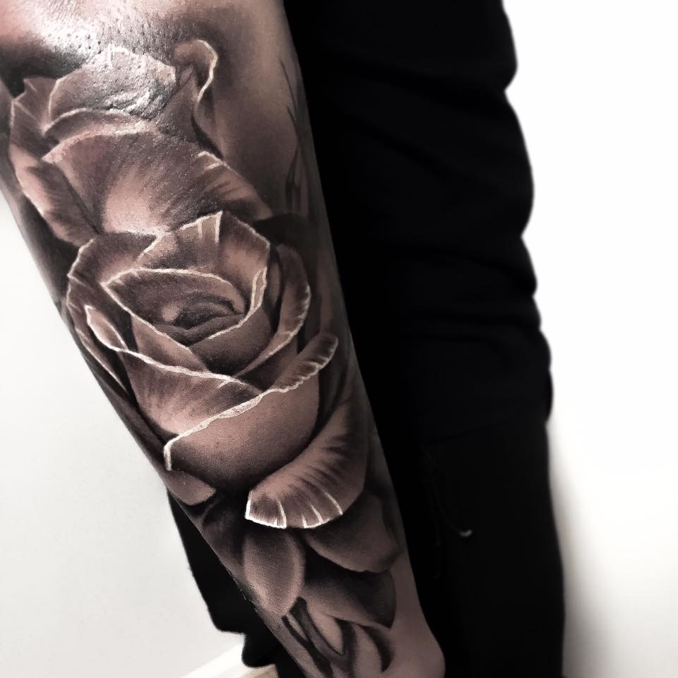 Grey Ink 3D Rose Tattoo On Arm Ideas And Designs