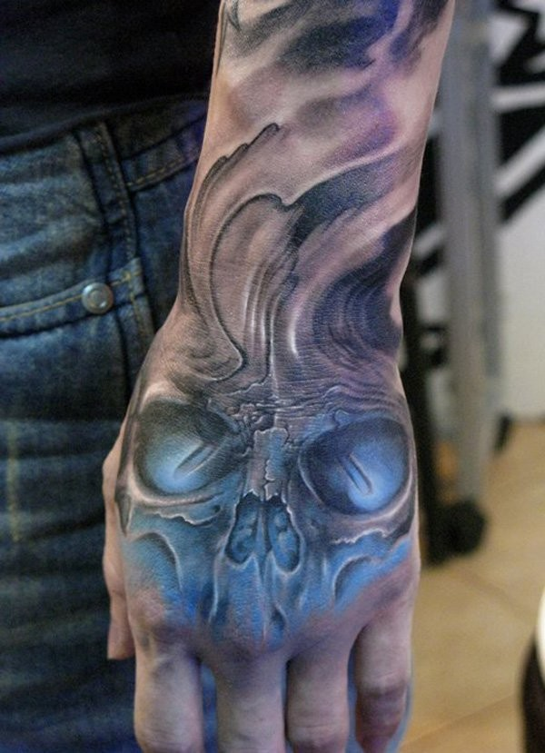 20 Skull Hands Tattoos For Men Ideas And Designs
