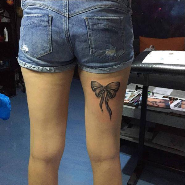 thigh bow tattoo