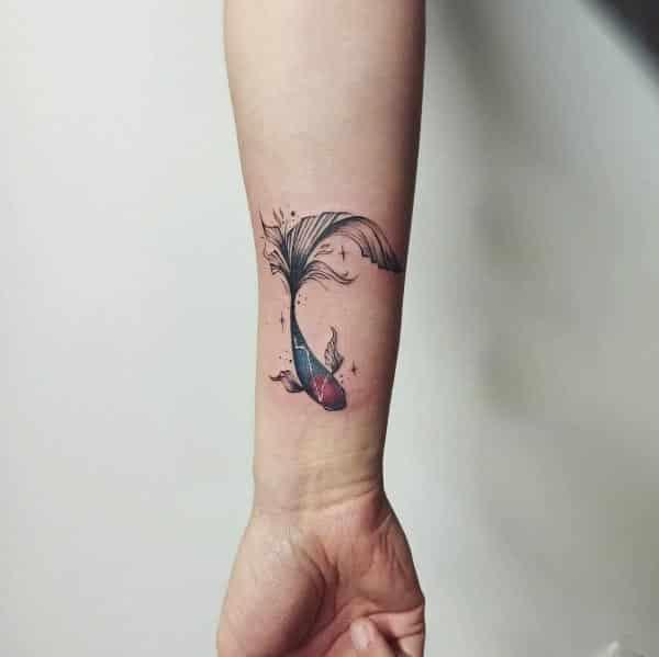 fish tattoo design on wrist