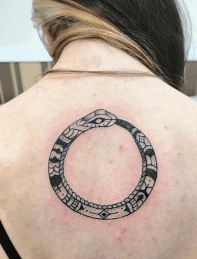 tribal snake eating its tale tattoo