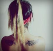 women tattoo - angel wings shoulder
