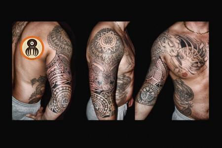 Tatuaje Maori En El Brazo Con Un Mandala En El Hombro