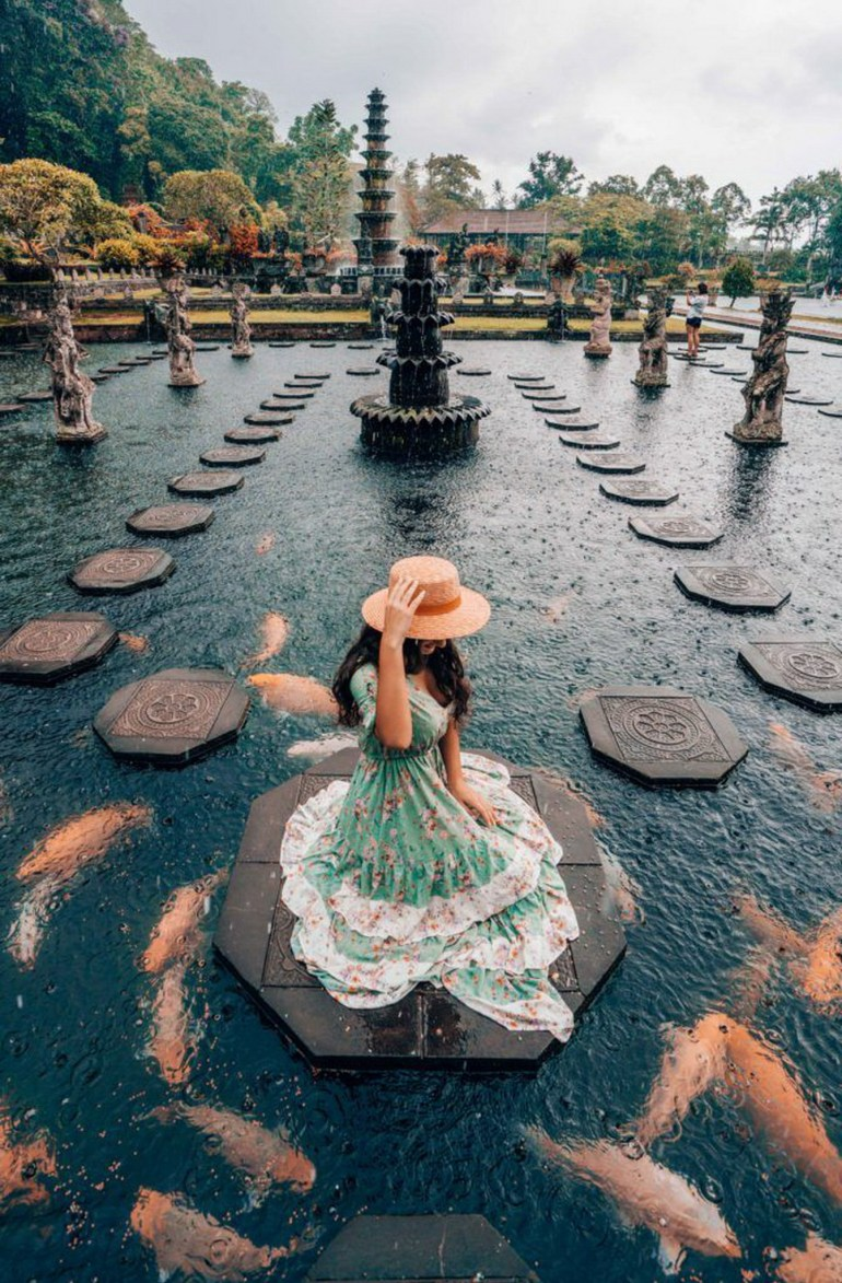 Tirta Gangga the Water Palace Karangasem Indonesia - Costume design, Dress, Finial, Gown, Hat, Outdoor structure, Sun hat, Tourism, Tourist attraction, Tower, Water feature
