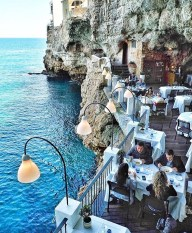 Polignano, Italy - Azure, Beach, Blue, Body of water, Clothing, Eco hotel, Leisure, Lighting, Person, Restaurant, Sky, Travel, Water