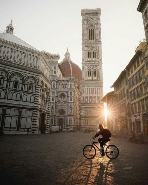 Cathedral of Santa Maria del Fio, Florence Florence Italy - Bicycle, Bicycle frame, Bicycle wheel, Building, Infrastructure, Land vehicle, Person, Public space, Road surface, Sky, Street light, Sunlight, Tire, Wheel, Window