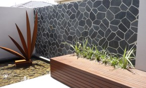 An Outdoor Feature Wall In Onyx Really Stands Out Backyard Garden pertaining to Backyard Feature Wall Ideas