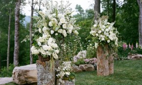 Backyard Wedding Altar Pretty Floral Arrangements On Cut Logs with regard to 11 Awesome Tricks of How to Improve Outdoor Backyard Wedding Ideas