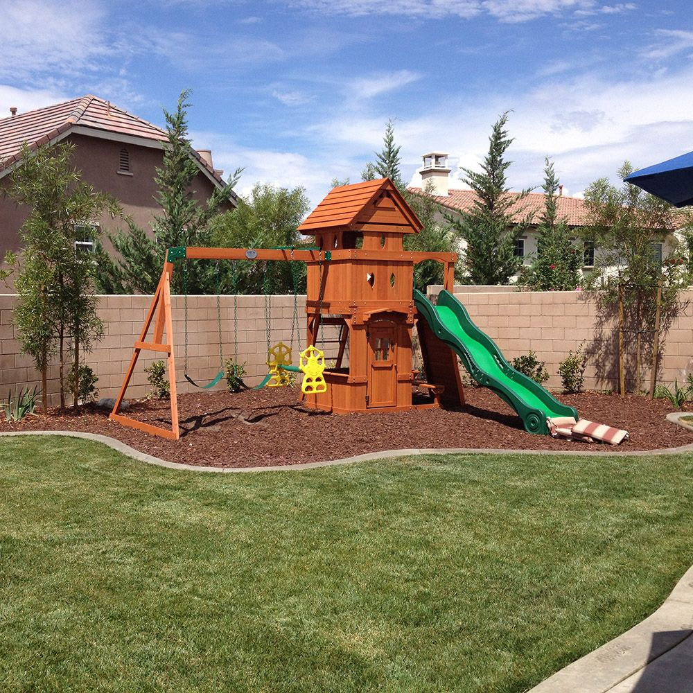 How To Landscape Under A Swing Set Helpfulhowtos Mccabeslandscape with Backyard Swing Set Ideas
