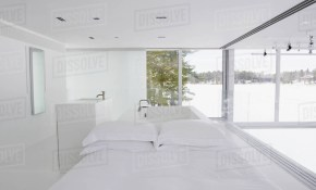 Modern White Bedroom With Tub In Background Stock Photo Dissolve for 13 Clever Ways How to Improve Modern White Bedroom