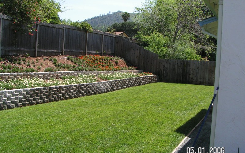 Retaining Wall Slope Down To Flat Backyard Gardenyard Sloped inside 14 Some of the Coolest Ways How to Makeover Backyard Wall Ideas