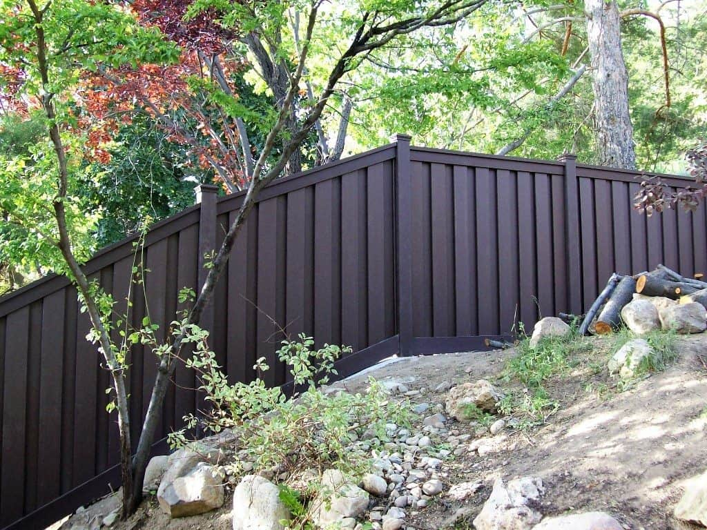 Black Painted Fences On A Slope Instructions To Build Fences On A throughout Painting Backyard Fence