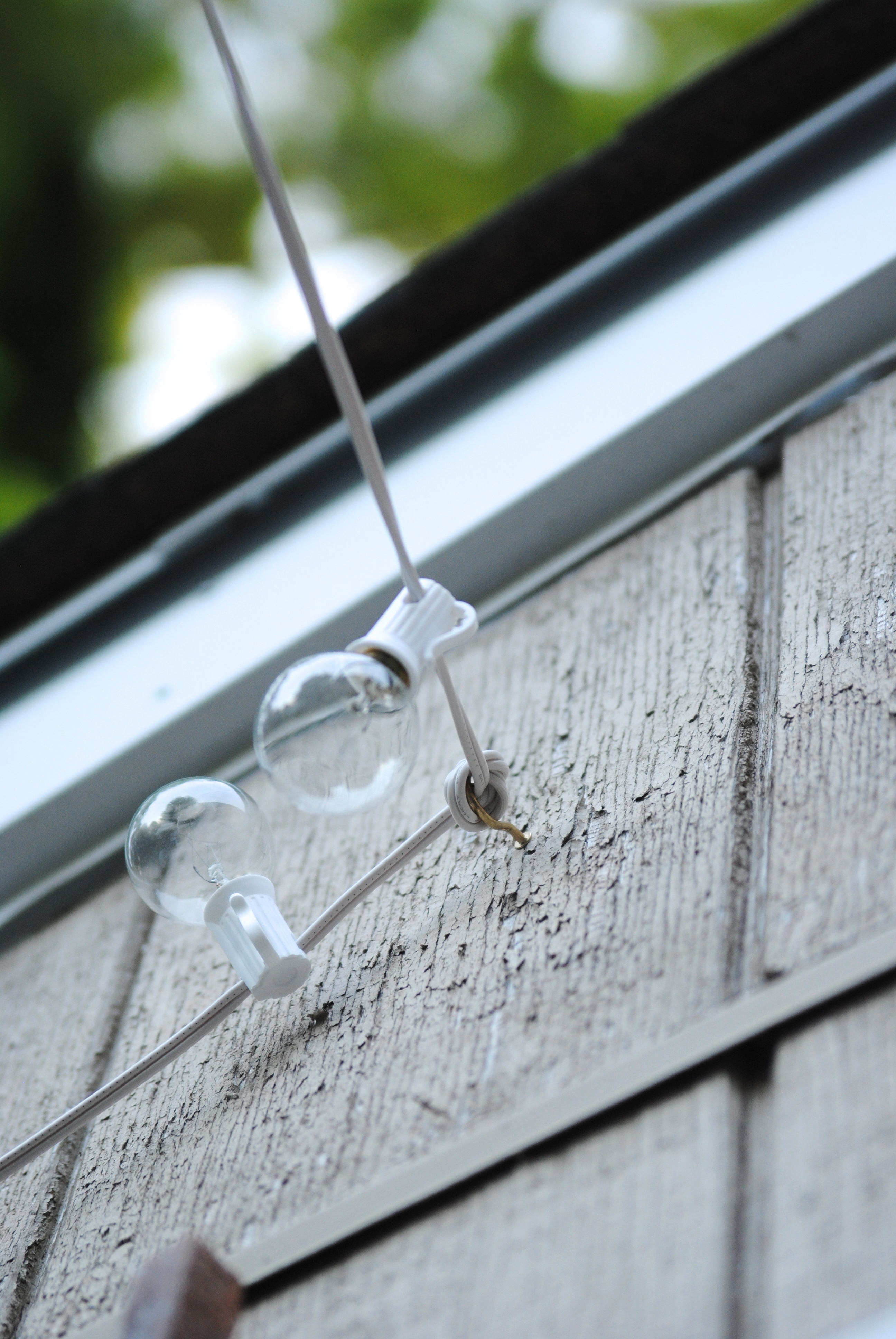 How To Hang Outdoor String Lights The Deck Diaries Part 3 pertaining to Backyard String Light Ideas