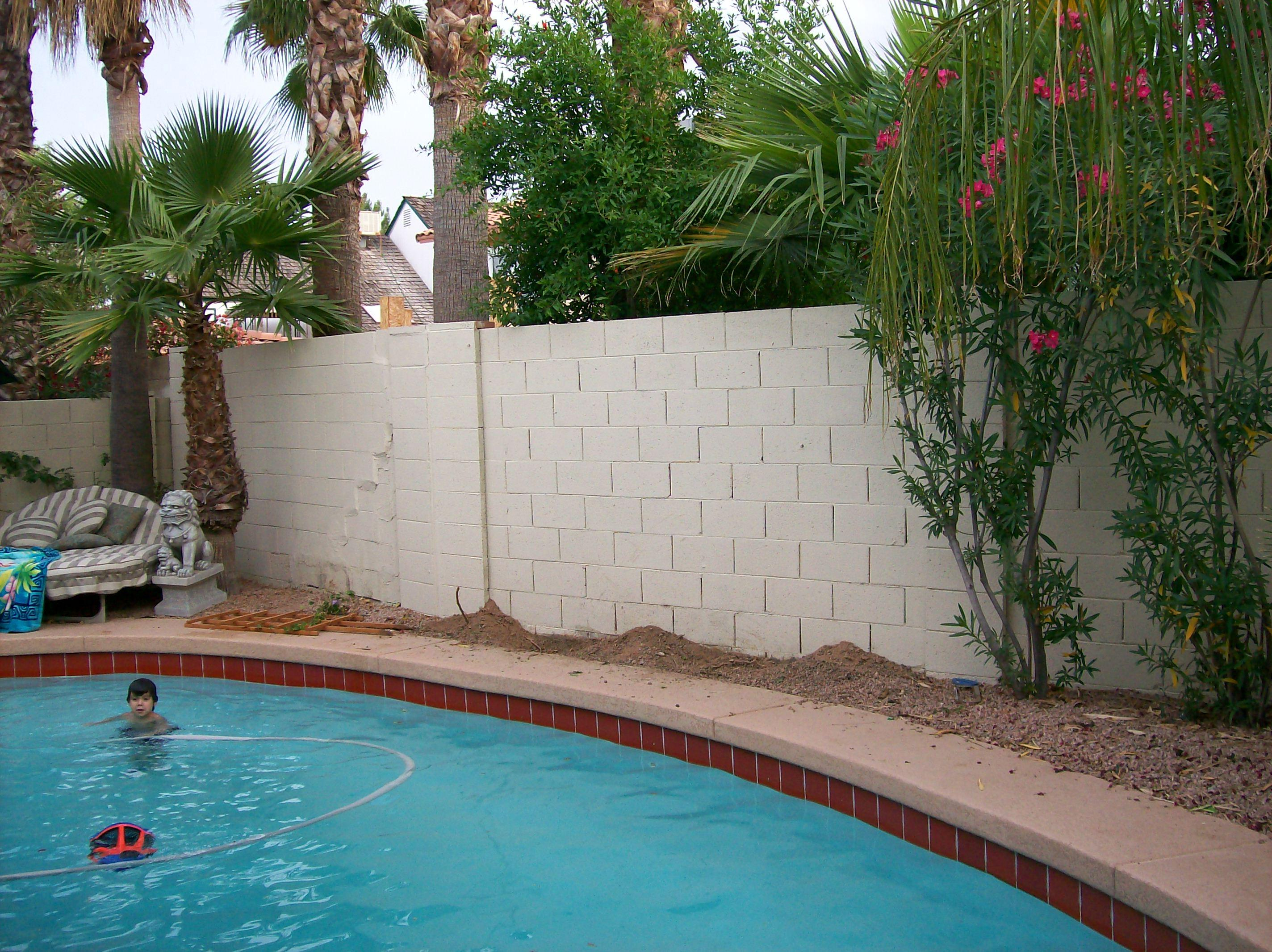 What A Little Stucco And Paint Can Do For Your Block Fence Tukee Talk within Painting Backyard Fence