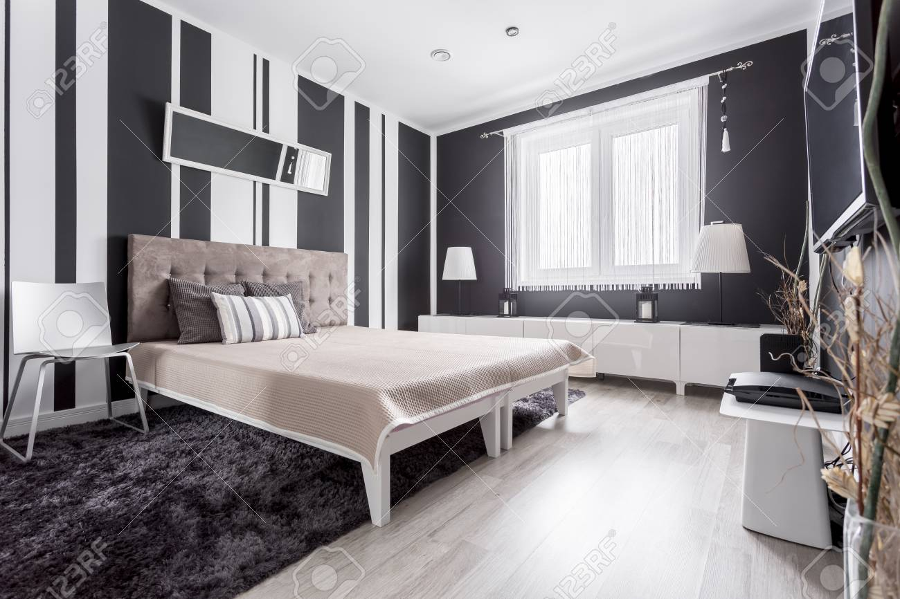 Luxurious Modern Bedroom With Striped Wallpaper And Bed With Stock within Modern Bedroom Wallpaper
