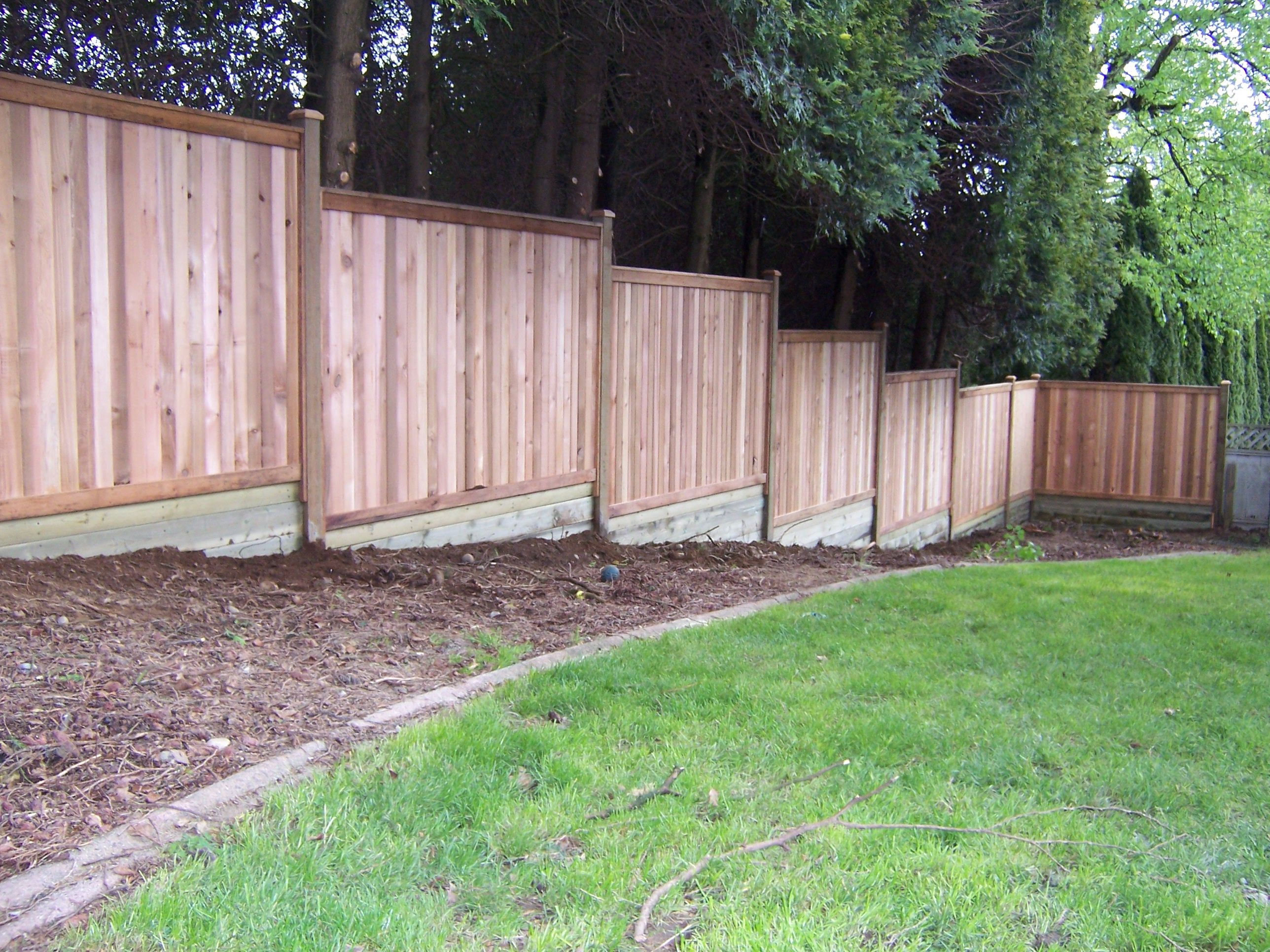 Privacy Fence Building Build A Fence On Sloped Ground Backyard intended for 11 Clever Ways How to Improve Backyard Fences