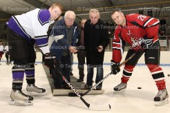 EMS's Kyle Stewart faces off with Fire's Jamie Sullivan. Dropping the puck are Wayne Krakowski and Jon Rowe.