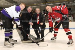 EMS's Kyle Stewart faces off with Fire's Jamie Sullivan. Dropping the puck are Don Junker and Brian Simmons.