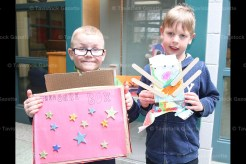 Grade 1 students Knox Glofcheski (left) with his Treasure Box and Brady Kuiack with his monster box creation on display in the Tavistock Public School entrance cases.