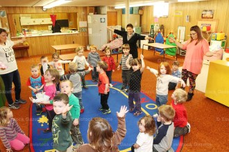 Students at Tavistock Pre-School (above) enjoy some songs and actions last week during their morning session in the basement of Tavistock Mennonite Church.