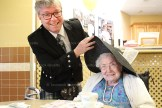 Residents at peopleCare, Tavistock, enjoyed a birthday tea in the nursing home's dining room on the occasion of Queen Elizabeth II's 90th birthday last Thursday, April 21st. Marie Kaufman gets her hat adjusted by Chaplain Will Kramer.