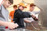 Grade 8 students manning the barbecue for the Camp Celtic Fundraiser on Saturday, above, from the left, Shawn Farrell, Alex Dingwell, Anikin Kirkbride, and behind, Peter Behnke.