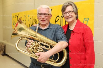 Ken Seltzer was honoured for 37 years as president of the New Hamburg Band. He is shown here with his wife, Judy, and holding the baritone horn he has played since starting in the Tavistock Citizens Band as a youth.