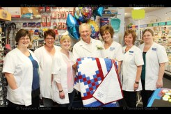 Employees surround Pharmacist Marc Michaud on his retirement last week. From the left are Heather Pfaff, Karen Bender, Manager Kristy Adair, Marc Michaud, Office Manager Glenna Roth, Lisa Iutzi, and Kim Hill.