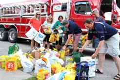 The Tavistock Firefighters held their 6th Annual Food Drive for T.A.P. with another overwhelming response of support from the community. Above, from the left are: Julie Brenneman, Linda Skinner, TAP Executive Director Sharon Walkom, Dan O'Hearn, Byron Kropf, and Chris Roth, in front.