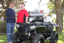 Dave Piggott (far left) accepts the brand new ATV as the grand prize in the Yantzi Home Building Centre's Off-Road Vehicle Contractor Giveaway held last Thursday morning, June 9, 2016. Congratulating him is Yantzi's Home Design Smart's Ryan Sim.