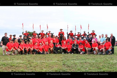 Members of the Tavistock Agricultural Society, dignitaries, special guests and volunteers pose for their official photograph at the RCMP Musical Ride in Tavistock on August 15, 2016.