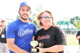 Québec pitcher Marc-Andre Villeneuve was named top player in the tournament. He was presented with the award by Softball Canada Supervisor Lisa Down.