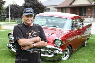 Jim Weicker stands proudly with his fully restored 1957 Chevrolet Bel-Air, a regular appearance at the Fall Fair Car Show.