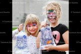 Sisters Eloise, 7, and Aude Stock-Bateman, 9 show off the goldfish they won on the midway.