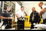 Christopher Pape of the Ontario Fire College explains the operations of a drone to East Zorra-Tavistock Fire Chief Scott Alexander and Tavistock Station Chief Paul Roth (right) at the Mutual Aid meeting on October 12th. At left is Firefighter Nick Hendry.