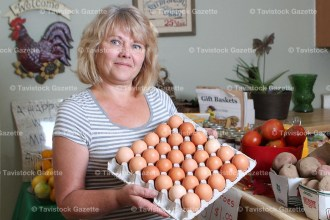 Nancy Loggan in her farm market store on the century farm at the village limits just west of Tavistock.