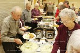 Patrons enjoy the beef dinner at Grace Unite Church.