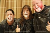 Hickson teachers, from the left, Jenny Christie, Jacquie George and Brent Houston give the thumbs up after searching for a jelly bean in a plate of whip cream at the Terry Fox Assembly last week.