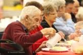 Elmer Wagler pours gravy on his dinner at the Tavistock Men's Club 58th Annual Roast Pork and Sauerkraut Supper on November 9th.