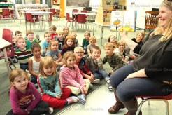 """Kindergarten students at Tavistock Public School enjoyed hearing the crazy, rhyming words of Dr. Seuss during a session in the school library last week. Above, Early Childhood Education teacher Jenn Schade (right) reads """"Hop on Pop"""" (1963) to the class."""