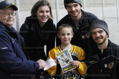 Cam Munro and his mother, Katrina, receive a cheque for $400 toward Minor Hockey registration from Royals chairman Terry Fewkes and Optimist Club of Tavistock Youth Committee representatives Griffin Zehr (top) and Colton Zehr at Minor Hockey Night on Saturday, January 14th.