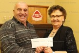 Renovation Project Chair Shirley McCall-Hanlon accepts a cheque for $2,000 from Tavistock Men's Club President Duane Kropf at their January meeting.