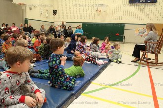 Primary students of Tavistock Public School listen intently as teacher Sandra Alyea offers a bedtime story last Tuesday evening.