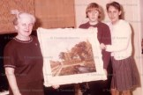 The late Miss Ida Kollman is presented with an oil painting in December of 1967 from Tavistock Public School students Bernice (Podann) Pengelly and Donna (Witzel) Zehr.