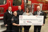 Muscular Dystrophy Development Coordinator Carrie Fischer accepts a cheque for $7,758.71 from the 2016 Boot Toll from Scotiabank Manager Phil Schaefer (right) and Tavistock Firefighters Scotty Zehr, and behind, Greg Bender and Andrew Raymer.