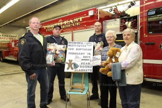 BEARS, BOOKS & BLANKETS: From the left are Shakespeare Fire Chief Greg Ankenmann, Captain Jeff Forthuber, Deputy Chief Steve Marriott, Hampstead W.I. secretary-treasurer Helen Anderson and President Winnie Trachsel.
