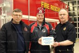 Stratford-on-Avon Shriners past president Carl Ohrling presents a replacement Burn Kit to Tavistock Station Deputy Chief Maury Sauder (left) and Township Fire Chief Scott Alexander.